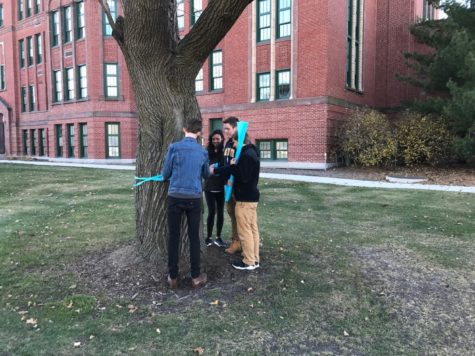 LT students tie ribbons, commemorating child's battle with cancer