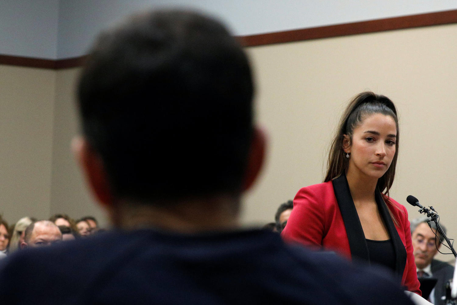 Victim and former gymnast Aly Raisman speaks at the sentencing hearing for Larry Nassar, (R) a former team USA Gymnastics doctor who pleaded guilty in November 2017 to sexual assault charges, in Lansing, Michigan, U.S., January 19, 2018. REUTERS/Brendan McDermid
