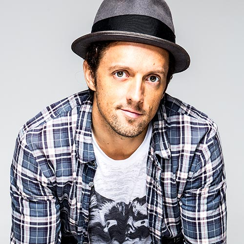 Jason Mraz posing for a promotional photo.
