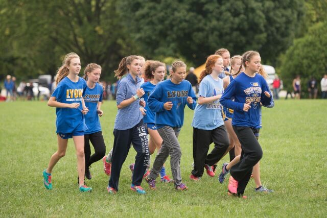 Varsity girls warming up prior to a race in Peoria (Photo courtesy  of Maddie Ohm '21).