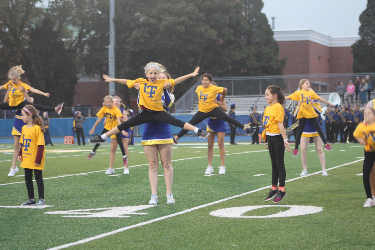 The LT Poms team performs with their younger partners (Sorice/LION).