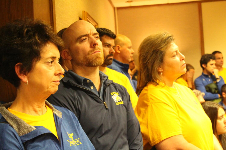Teachers watch the school board meeting on Nov. 16.