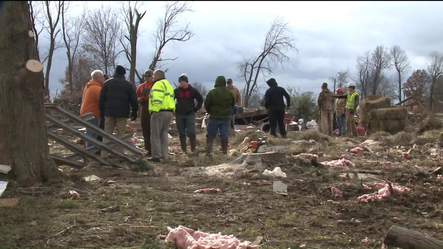 Residents survey the extensive damage done to homes in Taylorville (Tribune News Service).