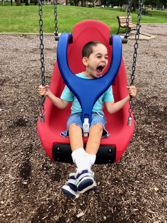 Parker Ramirez enjoys the new adaptive swing at Kiwanis park in Brookfield (Christine Ramirez).