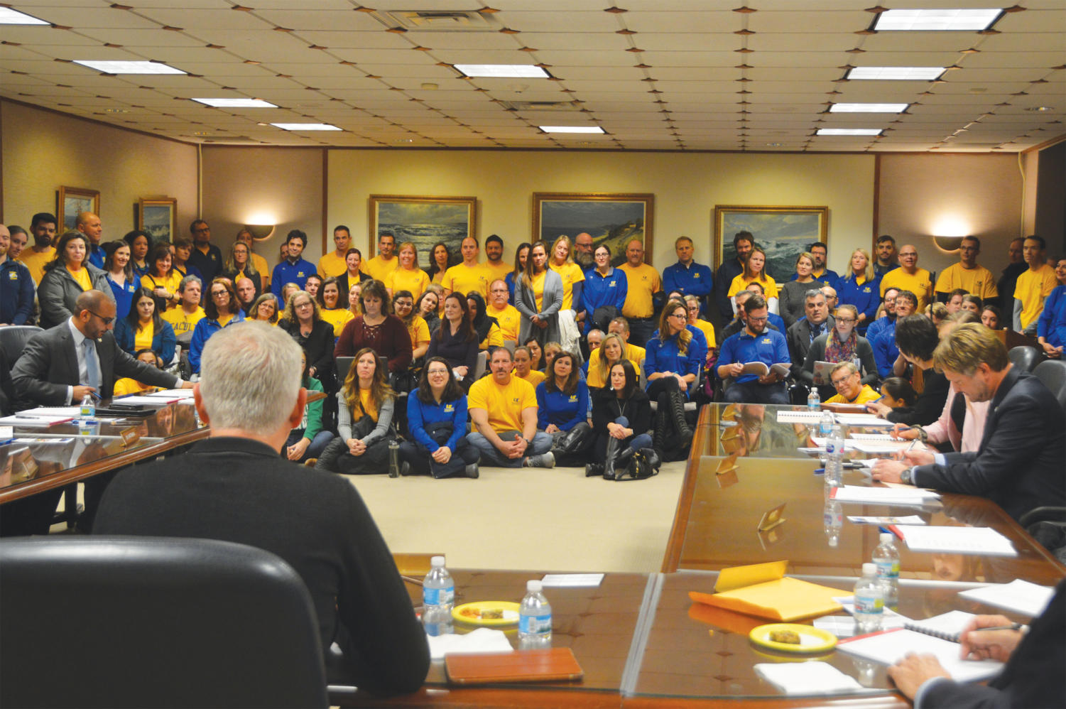 Teachers gather for the entirety of the Board of Education meeting in  NC room 104 on Nov. 19 (Breen/LION).