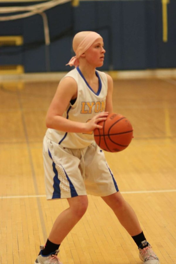 Despite being diagnosed with Hodgkin's Lymphoma, Allie Kuhlman '22 continues to play basketball for LT.  (Photo provided by Megan Guzlas)