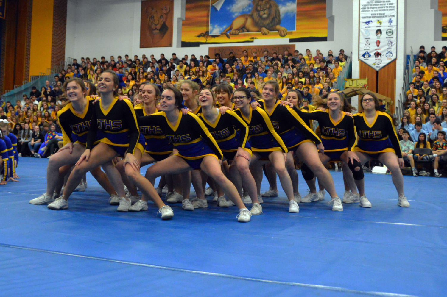 Cheerleaders+moves+together+during+their+routine.