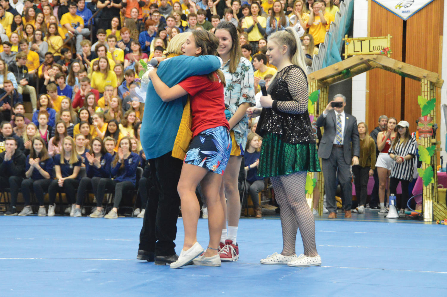 Kris+Costopolous+embraces+a+student+during+the+assembly.+Because+of+her+anticipated+retirement%2C+the+assembly+honored+here+for+starting+the+All-school+18+years+ago.