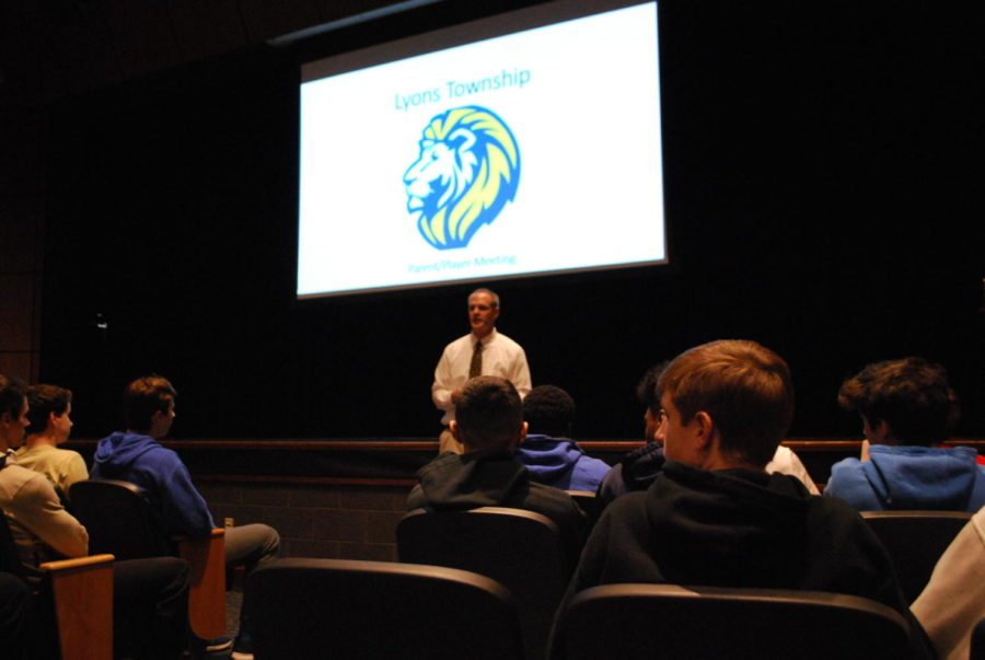 Hartman talks to players and parents about his goals for LT's football program at the Tuesday meeting (Valdes/LION).