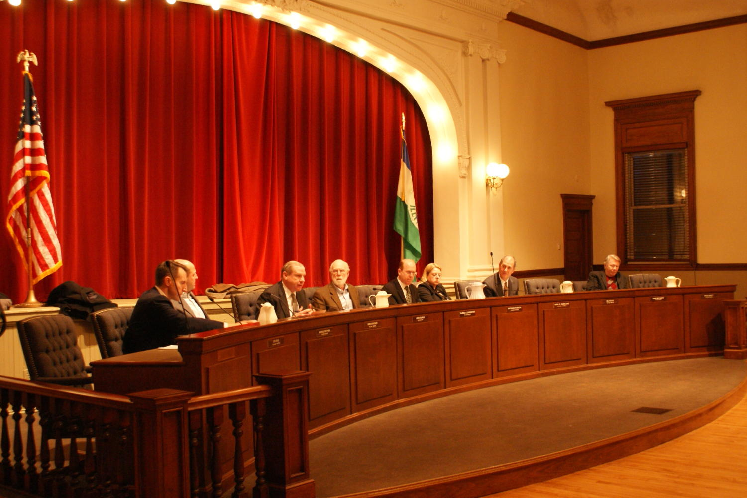 Village board members debate at the recent meeting (Shearrill/LION).