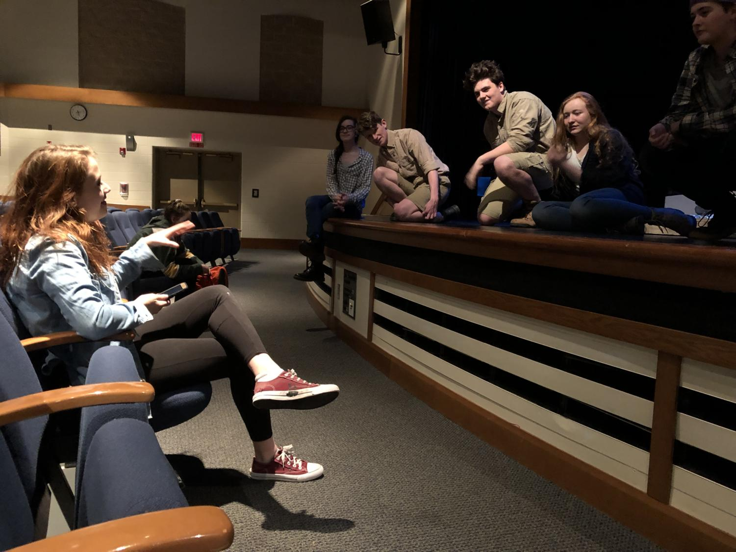 Ellie Burke '19 gives her actors notes after a run as they rehearse for   the Mavros festival (Schmitt/LION).