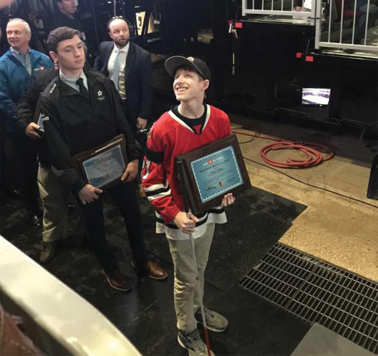 David Kopp '20 was awarded the Youth Player of the Month plaque by the Chicago Blackhawks on the Ice of the United Center Feb. 22. (Photos provided by Keeve)