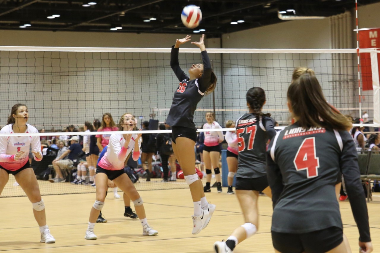 Lizzie Patel '21 sets up a hitter at a First Alliance volleyball tournament during her club season (photo courtesy of Patel).