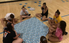 Girls Swim and Dive create blankets for hospitals