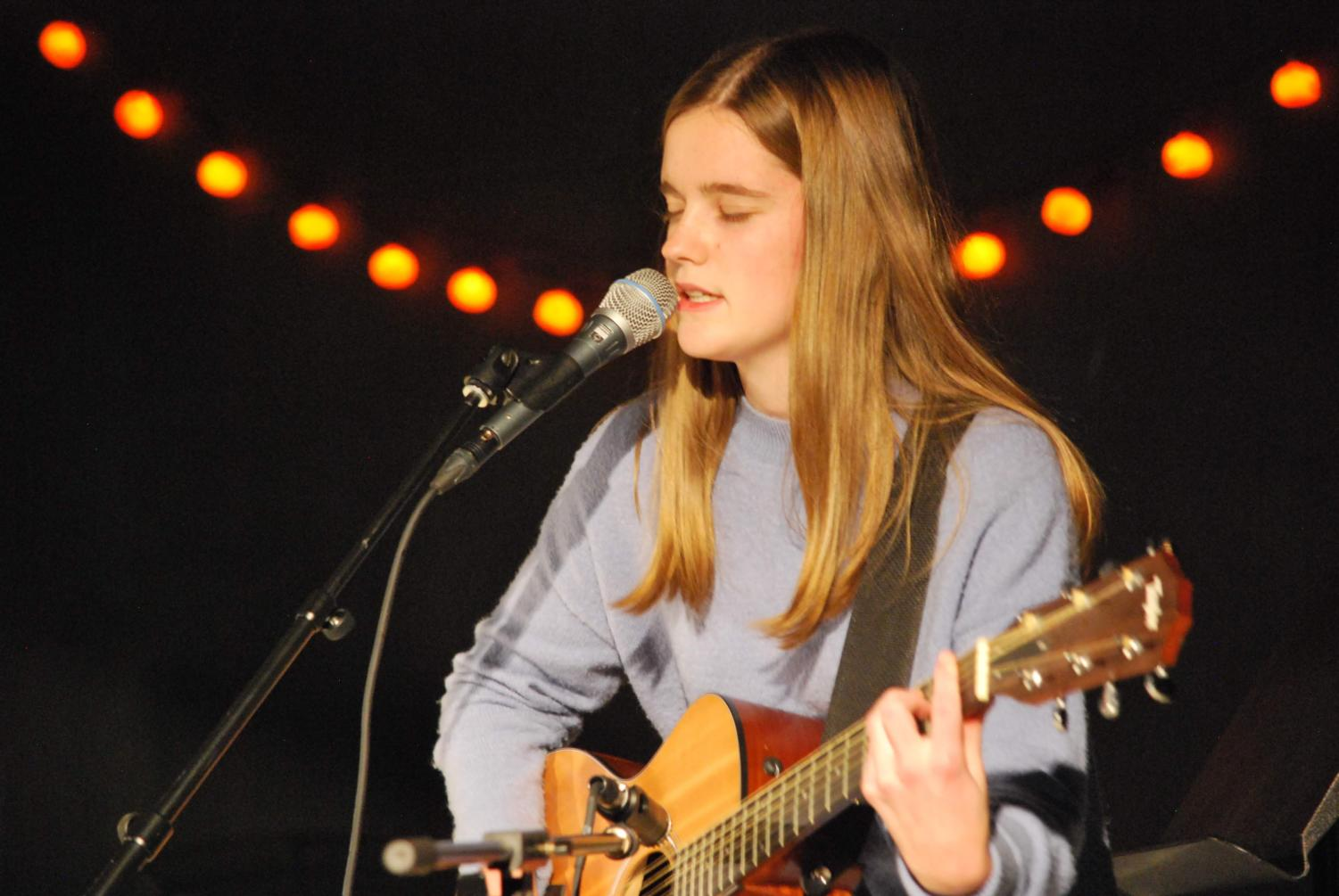Allison Keeley '20 sings an original song  and plays guitar at Monster Bash (Janik/LION).