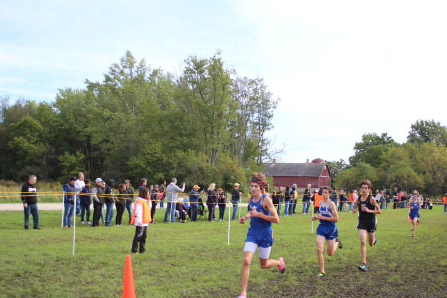 LT team surpasses opponents as the St. Charles North Invite race progresses (Williams/LION).