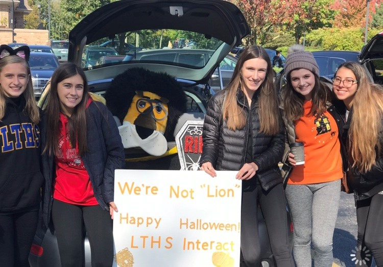 Interact+club+smiles+for+a+photo+at+the+%22trunk-or-treat%22+event+%28photo+courtesy+of+Maya+Albores%29.