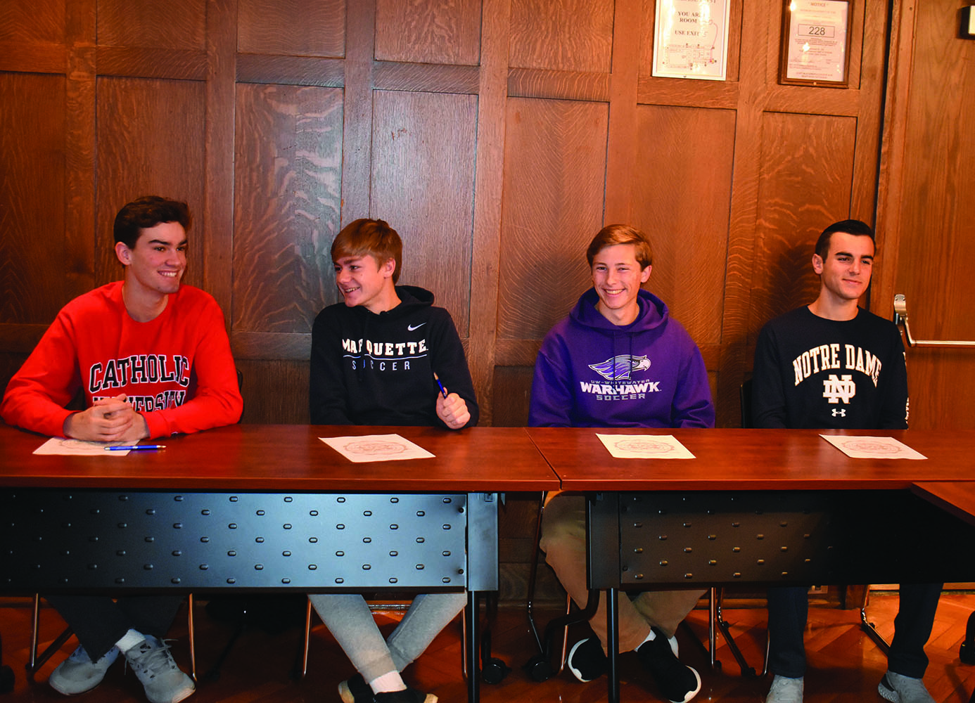 Luke Geraghty '20, Joey Fitzgerald'20, Zack Kristy '20 and Alex Salvino '20 chat and wait to sign (Riordan/LION).
