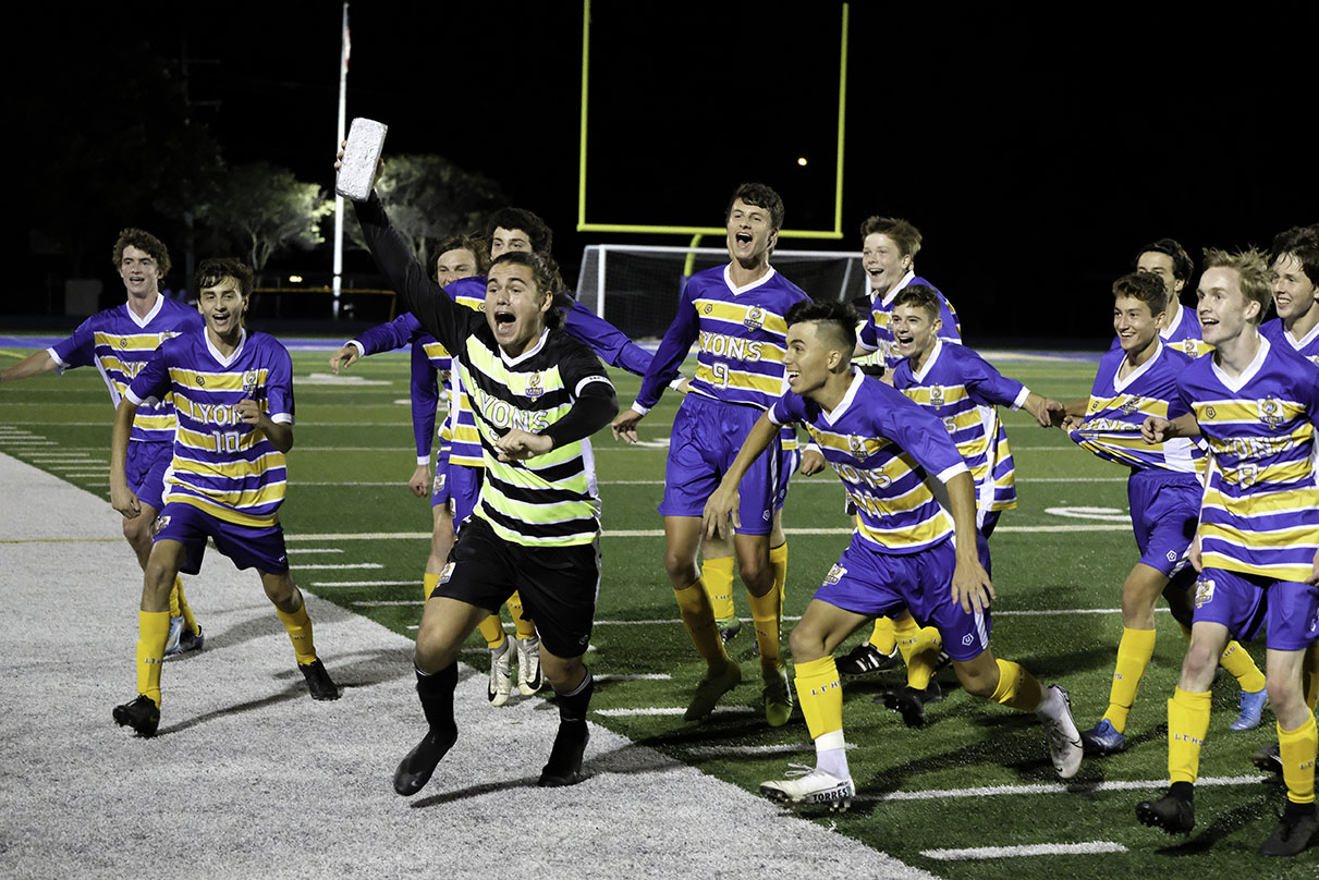 The varsity team ecstatically ran off the field to celebrate with their fans after winning the Silver Brick against Hinsdale Central on Sept. 26 (courtesy of Anthony Fertitta).