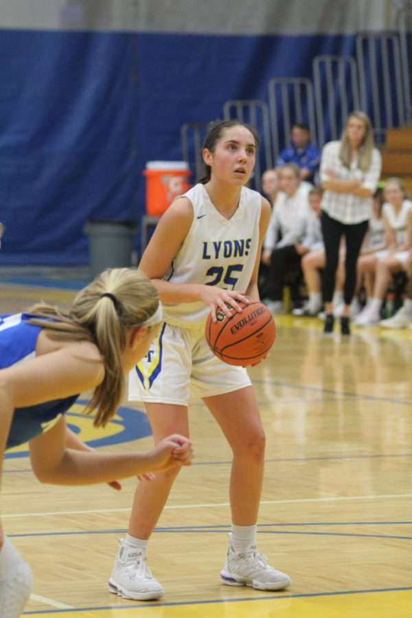 Hailey Markworth '22 shoots a freethrow during the tournament game against Wheaton North on Nov. 30 (Sorice/LION).