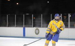 Aidan Sheehan '20 skates across ice on the Bobby Hull Community Ice Rink (photo courtesy of Jelena Cejka).