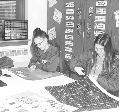 Students work on collages about the history of fashion during class (Shearill/LION).