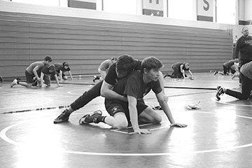 Andrew Schodrof '20 (LEFT) attempts to pin Paul Cozzi '21 (RIGHT) during a drill at practice on Jan. 21 (Riordan/LION)