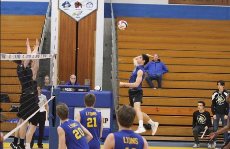 Right-side hitter Miki Dubak '20 jumps for the spike against Leyden High School in the NC fieldhouse on May 2, 2019.
