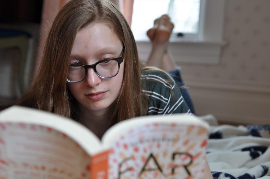 Sophia Schultz '21 reads one of the book in her social distancing book club.