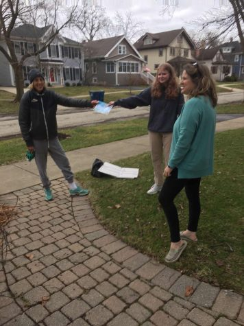 Livi and Darcy Kriha stand 6ft away from their neighbor as they help in whatever way they can (courtesy of Livi Kriha).