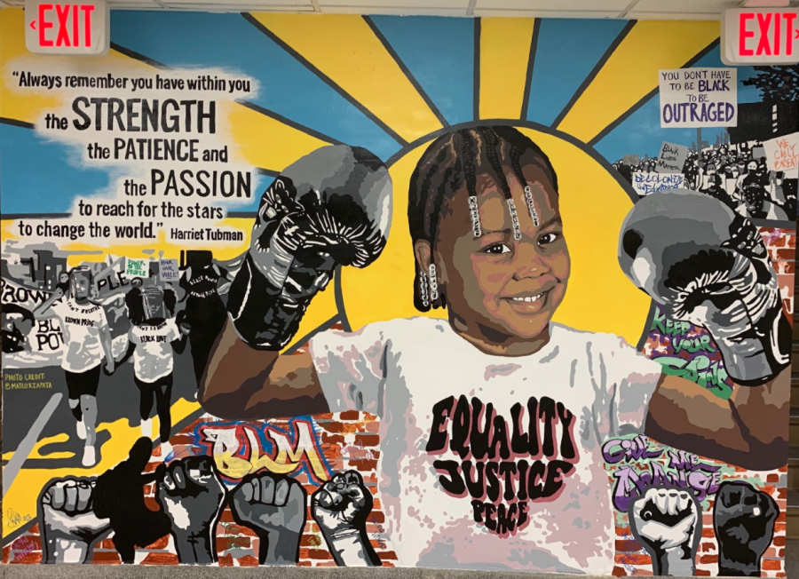 Diversity+mural+located+at++Lyons+Township+north+campus.+Photo+by+Janessa+Mosqueda+%E2%80%9822