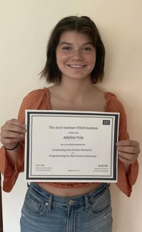 Addy Volz holding her summer STEM certificate (Lindsey Volz)