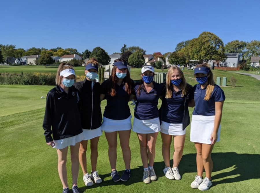 Varsity girls golf members at their regional competition.