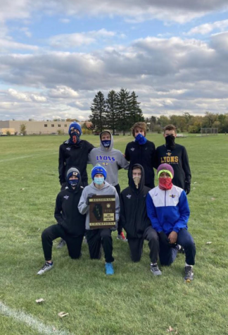 Cross country team after becoming regional champions (photo by boys cross country coach Mike Danner)