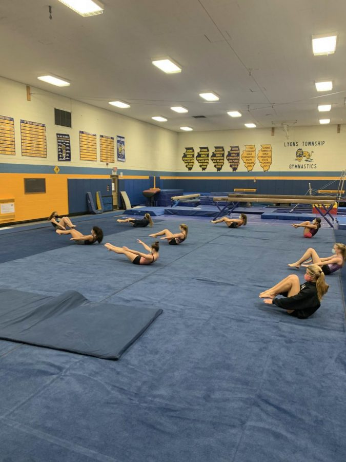 Girls gymnastics team at practice before the pause on sports. (photo by Darragh McDermott)