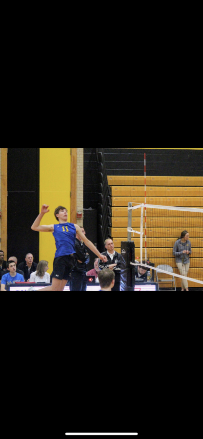 Markworth goes up for a spike at a LT volleyball game (photo by Jason Markworth)