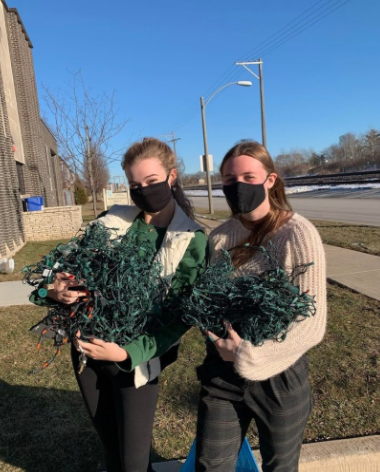 LT Recycling Club members Lindsey Moran '21 and Lauren Klusendorf '21 with collected lights at North Campus (Joan Machaj '21)