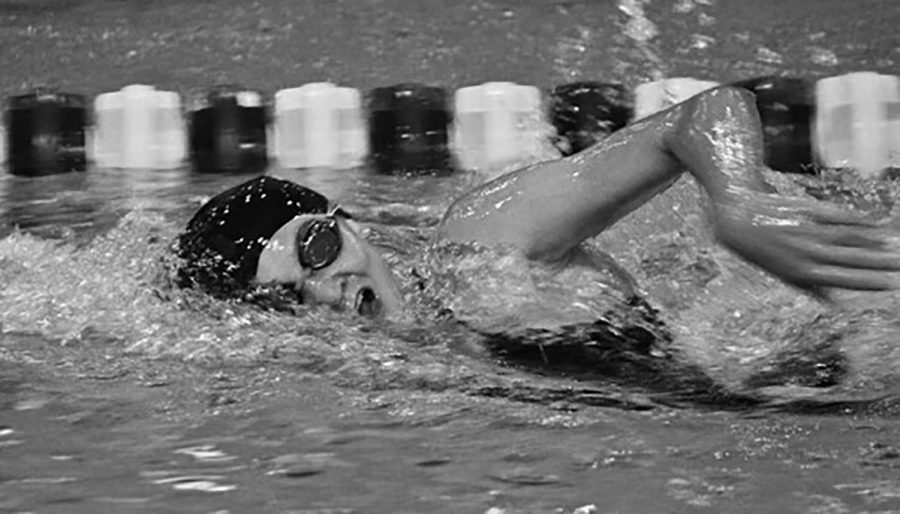 Emily Claesson swims at a meet between Lyons Township at Hinsdale Central during her time at LT (photo courtesy of Claesson).