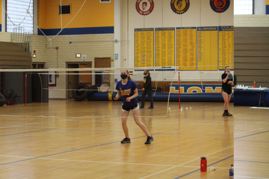 Claire Corrigan '22 gets a ready position to receive a shot at a home meet against Downer's Grove North on Feb. 17 (Ferrell/LION)