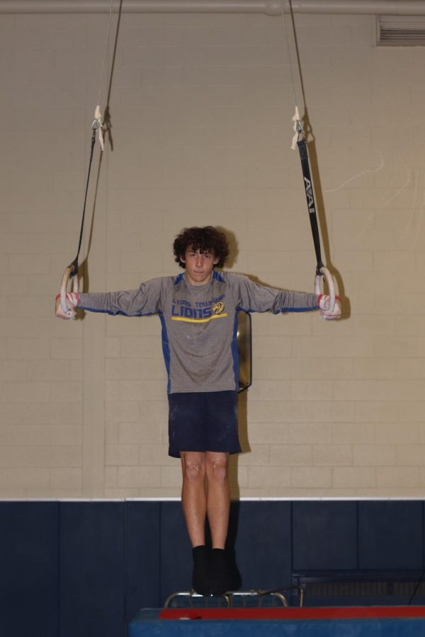 Ben Taylor '21 holds an iron cross during practice (photo courtesy of Cahill).