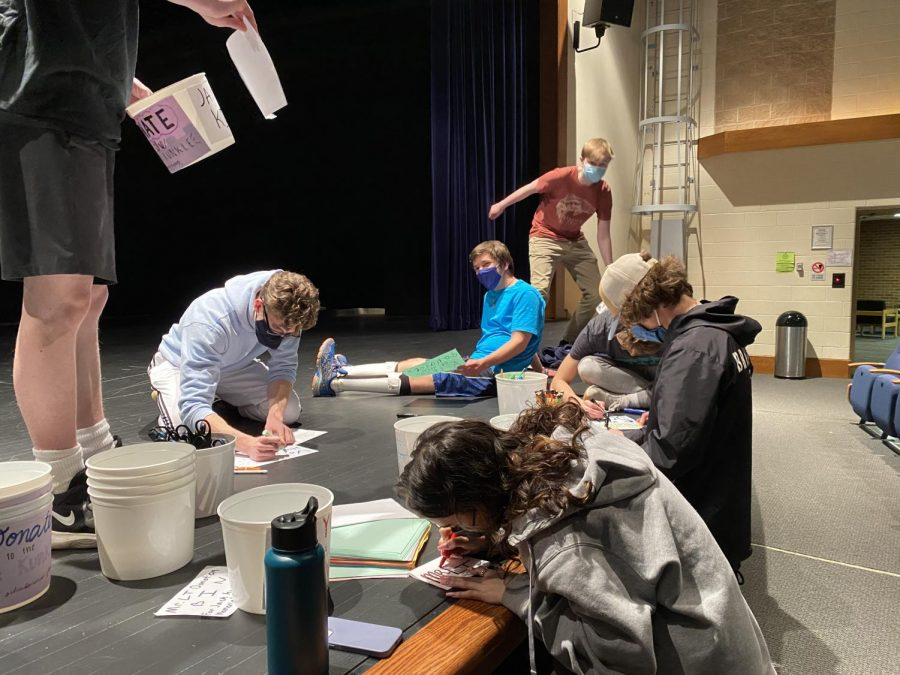 Mr.+LT+participants+decorating+buckets+to+collect+donations+