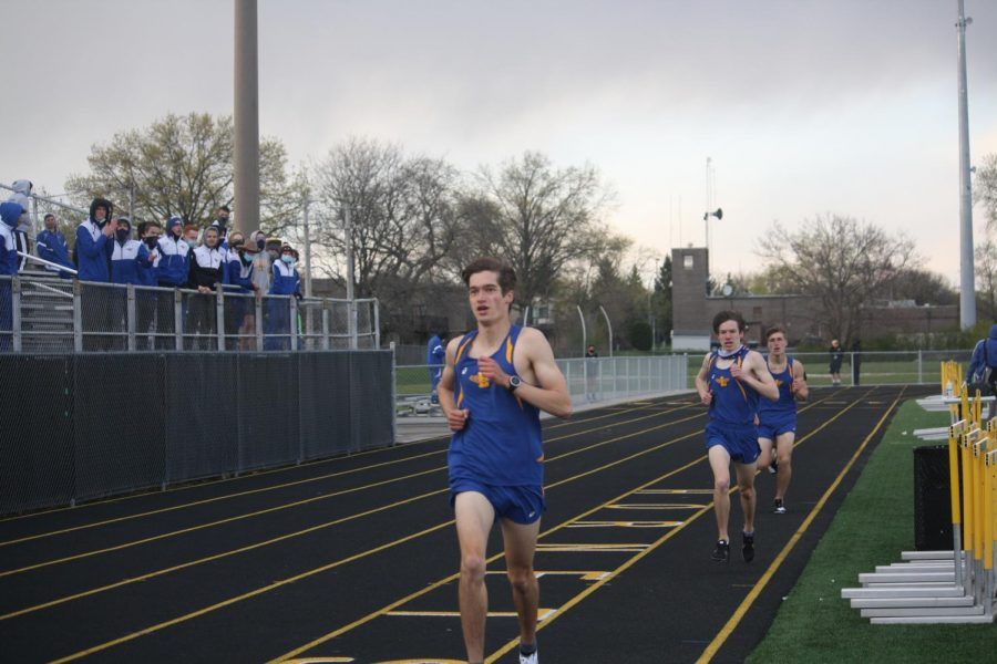 (Left to right) Hayden Constas 22, Sam Nowak 21 and Cade Nelson 21 race in the 1600 meter at Hinsdale South High School on April 21 (Chomko/LION).