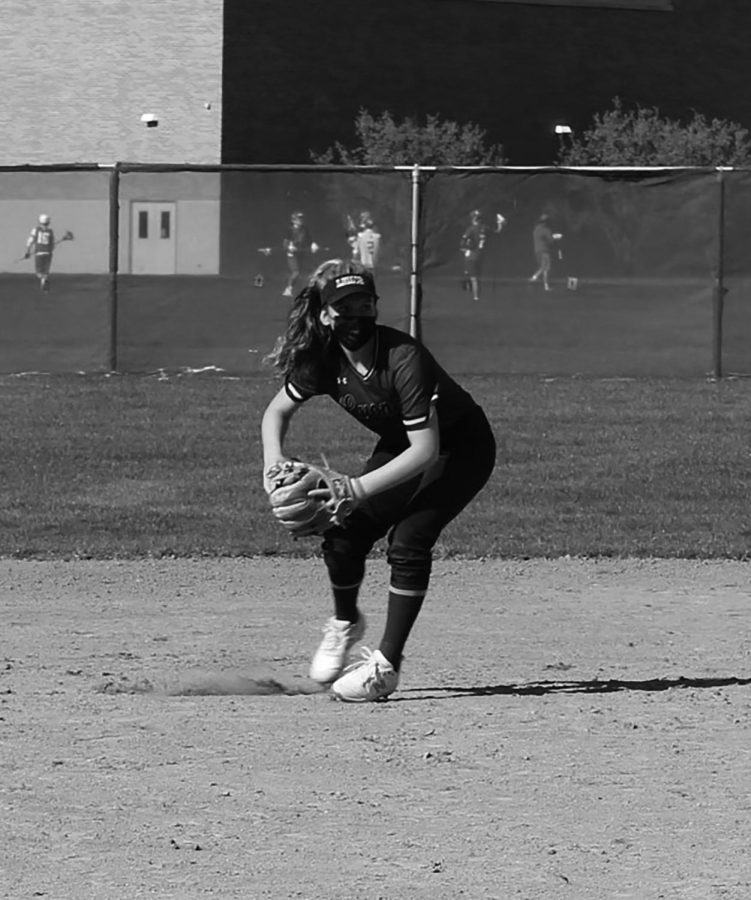 Ava Paganis 22 prepares to make a throw during an infield drill at practice on April 12 at the South Campus varsity softball field (Dike/LION).