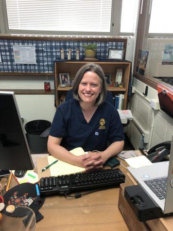 LT Nurse Megan Styx posing in her work attire (Fry/LION).