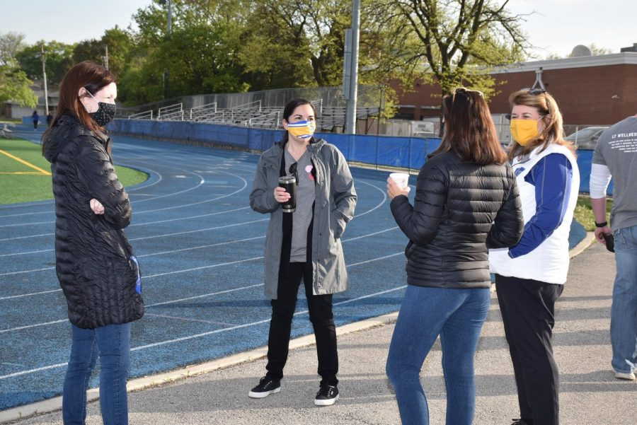 Principal Tyrrell meets LT faculty and staff at the Wellness Walk before school on Friday May 7 (photos by Randy Antlept).