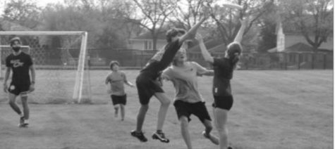 Three players jump and compete to catch a pass during a Tuesday practice at the fields behind the Corral (Ferrel/LION).