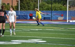 Goalie Izzy Lee '22 goes to punt the ball.