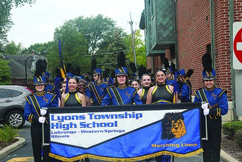 Band members pose before their march at La Grange Pet Parade (Mahaney/LION).