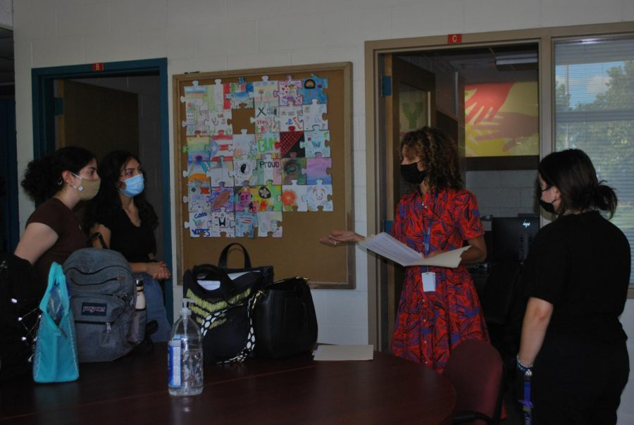 From left to right: Angelica Borrego 22, Janessa Mosqueda 22, Jennifer Rowe, and Ibet Herrera meet in B101 to discuss care space (Quealy/LION).